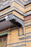 Rue Peter Benoit 2-4 et chaussée de Wavre 517-519, Etterbeek, premier étage côté rue, corbeau droit du balcon droit (© APEB, photo 2016).